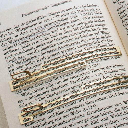 """Wolfgang Rahs - Earrings on book - """"Erkenntnistheorien des 20. Jahrhunderts"""""""